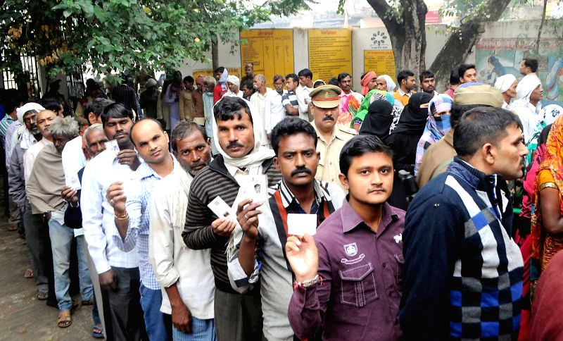 People queue-up to cast their votes during Uttar Pradesh panchayat polls in Allahabad  on Oct 29, 2015.