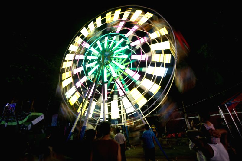 People ride ferris wheel during the Thadingyut Festival in Yangon, Myanmar, Oct. 28, 2015. The Thadingyut lantern festival is held on the full moon day of the ...