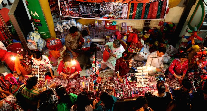 People select items at the Teej Fair for the upcoming Teej festival.