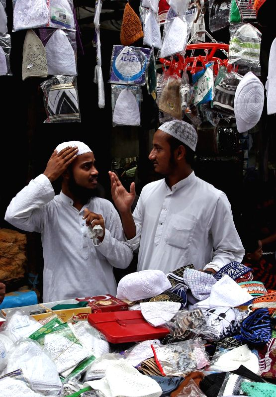 People sell prayer caps ahead of Eid ul-Fitr outside Nakhoda Masjid in Kolkata on July 28, 2014.
