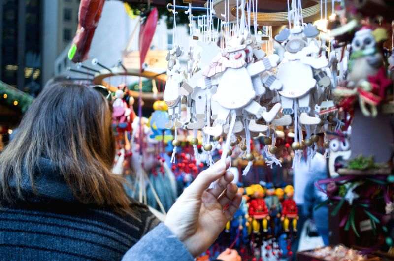 People shop at the Christkindlmarket in Chicago, Illinois, the United States on Dec. 9, 2015. Christkindlmarket, an annually Christmas market in Chicago, was first held by the German ...