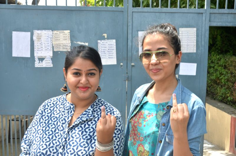 People show their fingers marked with phosphorus ink after casting their votes during MCD polls in New Delhi on April 23, 2017. Voting for municipal elections across 272 wards of the city ...