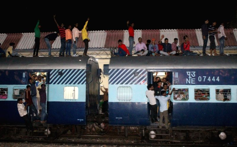 People sitting on the roof of an overcrowded train to participate in Goverdhan Mudiya Mela in Mathura on July 18, 2016.