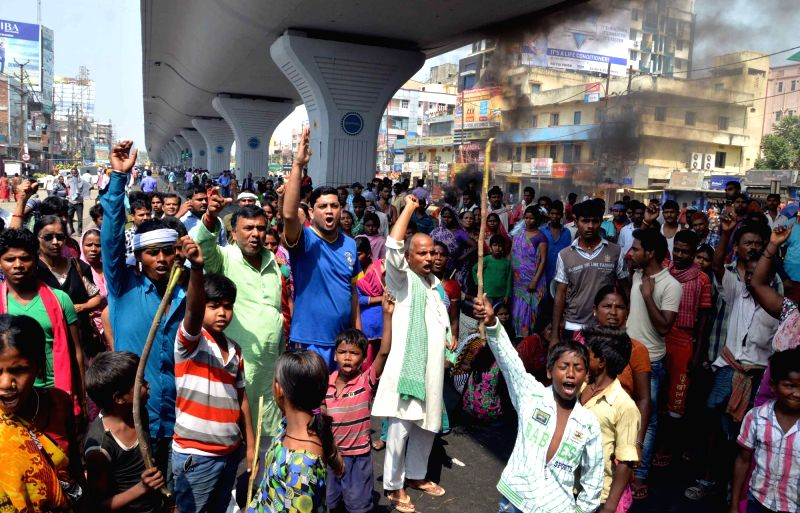 People stage a demonstration after three people were crushed to death by a vehicle in Patna on April 5, 2016.