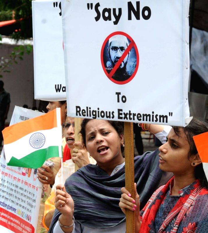 People stage a demonstration against controversial Islamic preacher Zakir Naik in New Delhi, on July 18, 2016.