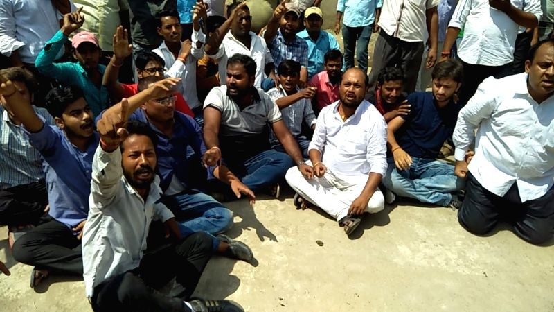 People stage a demonstration against Brajesh Thakur, the main accused in the Bihar shelter home horror case, outside a district court where Thakur was produced in connection with his ...