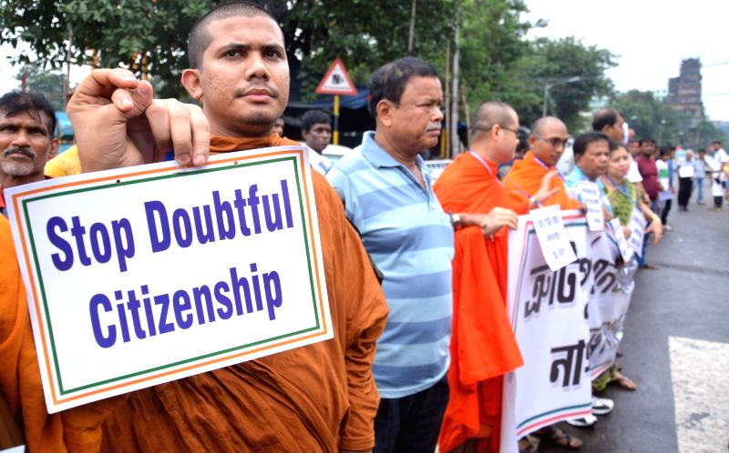People stage a demonstration against National Register of Citizens (NRC) of Assam that excludes over 40 lakh names; in Kolkata on Aug 1, 2018.