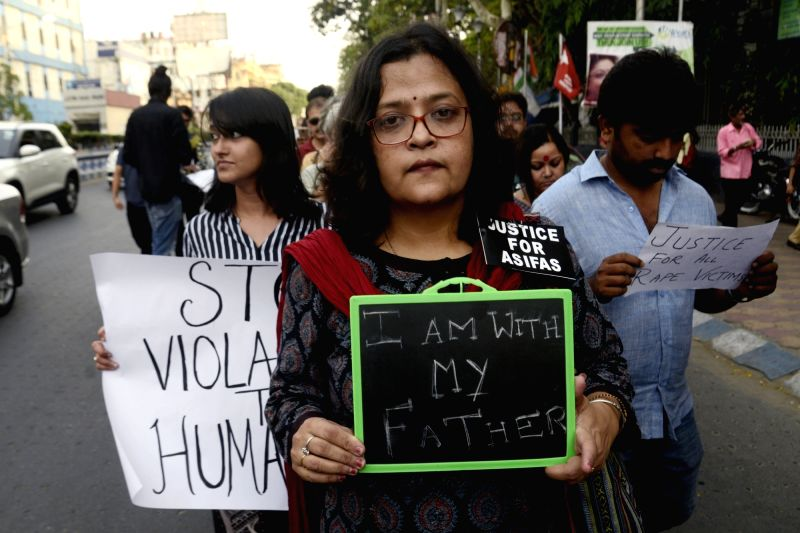 People stage a demonstration against the increasing incidents of rape, in Kolkata on April 21, 2018.
