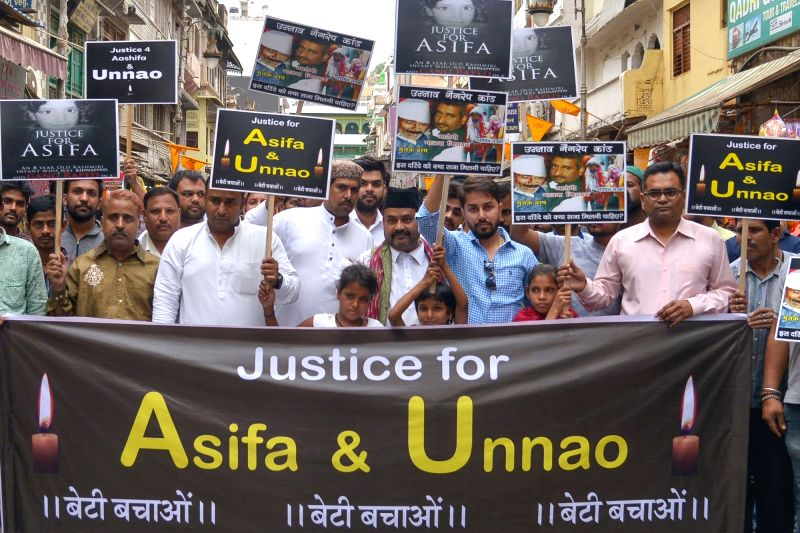 People stage a demonstration to protest against incidents of rape in Unnao (Uttar Pradesh) and Kathua (Jammu and Kashmir) in Ajmer on April 13, 2018.