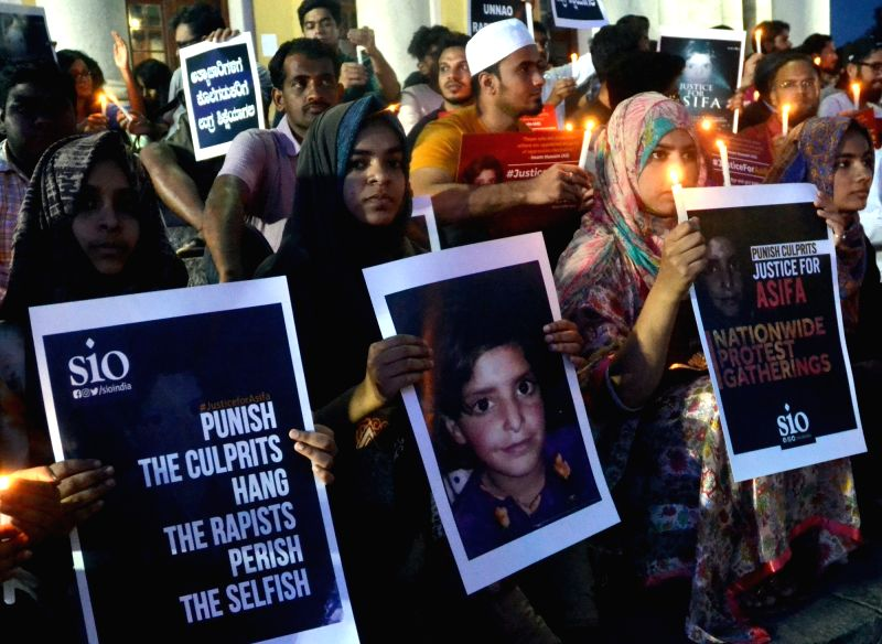 People stage a demonstration to protest against incidents of rape in Unnao (Uttar Pradesh) and Kathua (Jammu and Kashmir) in Bengaluru on April 13, 2018.