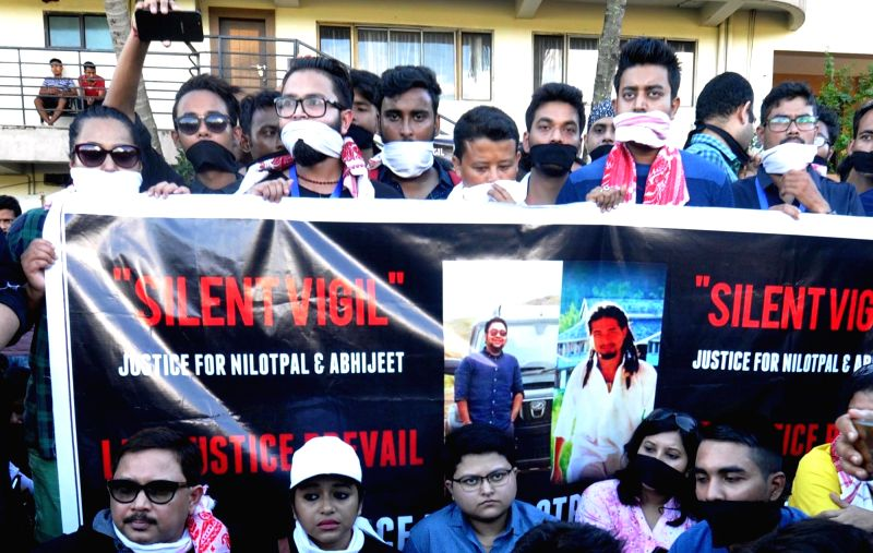 People stage a silent demonstration against the lynching of two Guwahati-based youths in Karbi Anglong district by villagers who mistook them to be child abductors and demand punishment for ...