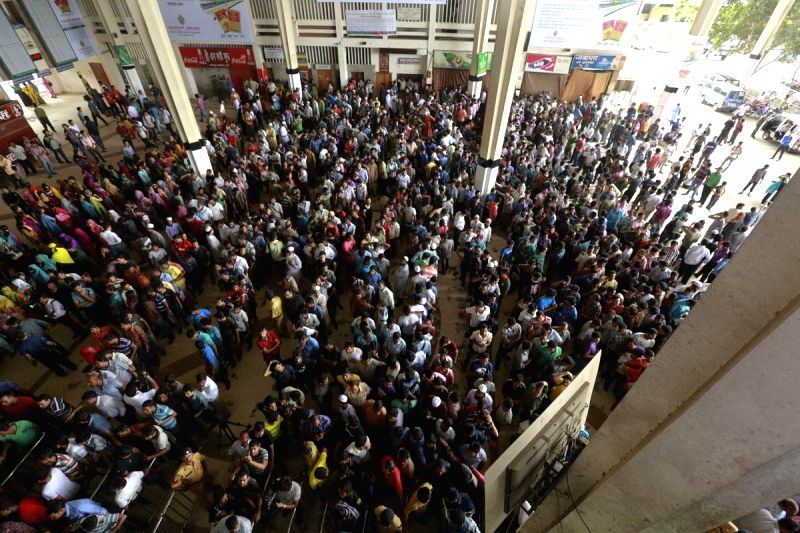 People stand in serpentine queues to buy tickets at Kamalapur Railway Station ahead of Eid-ul-Fitr in Dhaka, Bangladesh on July 20, 2014.