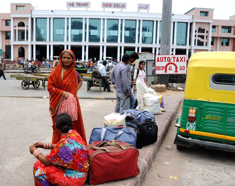 People stranded at New Delhi Railway station as auto-rickshaw drivers go on a day's strike against alleged highhandedness of traffic police and transport department in New Delhi on July 28, 2014.