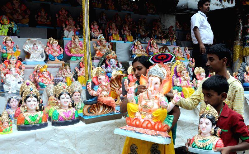 People  take Gauri-Ganesh idols ahead of Gauri Ganesha Festival in Bangalore on Aug 28, 2014.