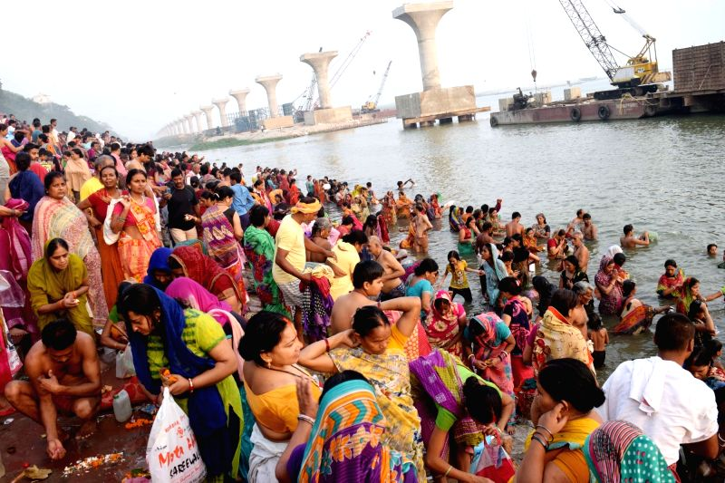 People take holy dip in the Ganga river during Ganga Dussehra in Patna, on June 4, 2017.