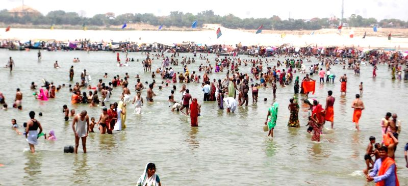 People take holy dip in the Ganga river during Ganga Dussehra in Allahabad, on June 4, 2017.