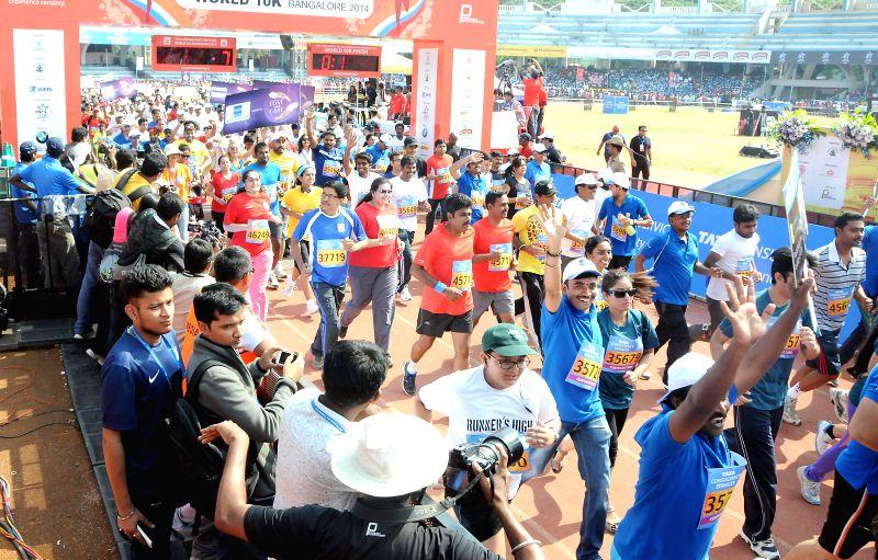 People take part in  'TCS World 10K Bangalore' at Kanteerava Stadium in Bangalore on May 18, 2014.