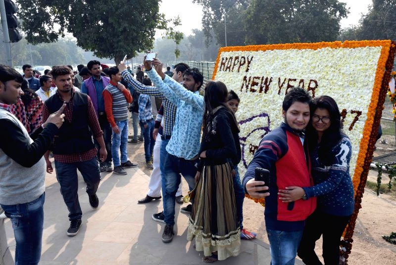 people take selfies with a new year greetings at india gate in new delhi on jan