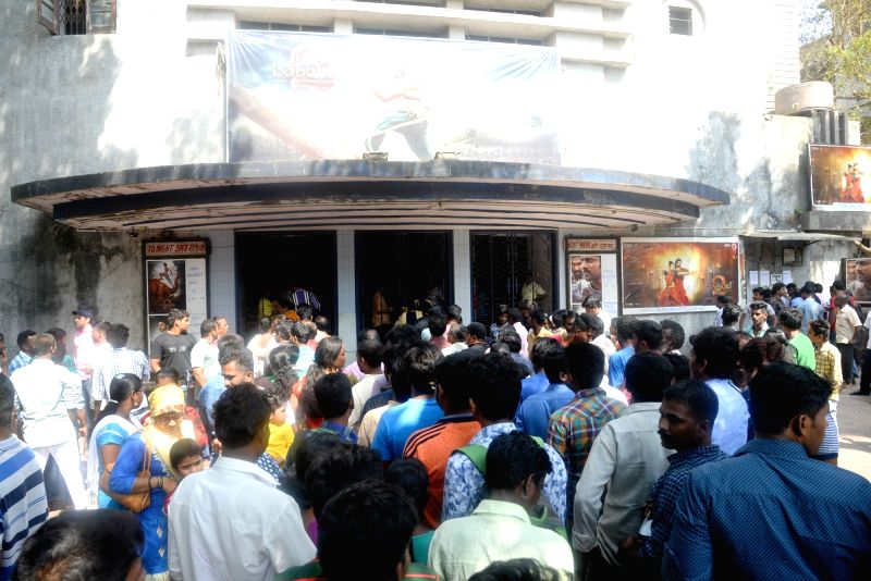"People throng a cinema hall to watch ""Baahubali 2"" in Mumbai, on April 28, 2017."