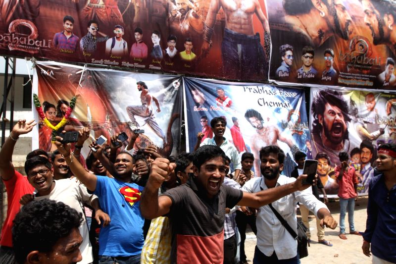 """People throng a cinema hall to watch """"Baahubali 2"""" in Chennai, on April 28, 2017."""