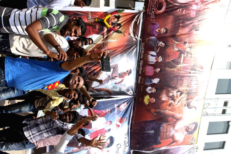 "People throng a cinema hall to watch ""Baahubali 2"" in Chennai, on April 28, 2017."