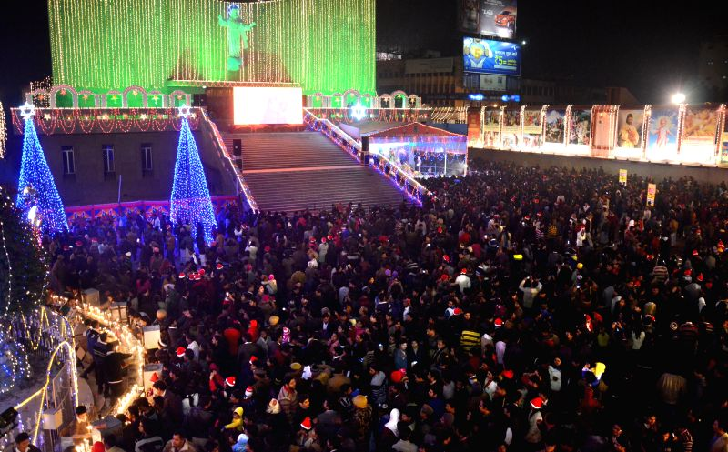 People throng a Lucknow church on Christmas on Dec 25, 2014.