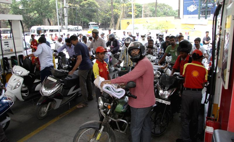 People throng a petrol pump in Bengaluru as some of them were forced to shut down due to short supply on April 5, 2016.