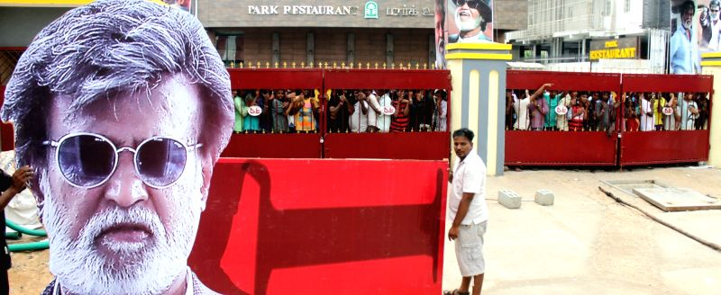 People throng a theatre to buy tickets for film Kabali in Chennai on July 21, 2016.