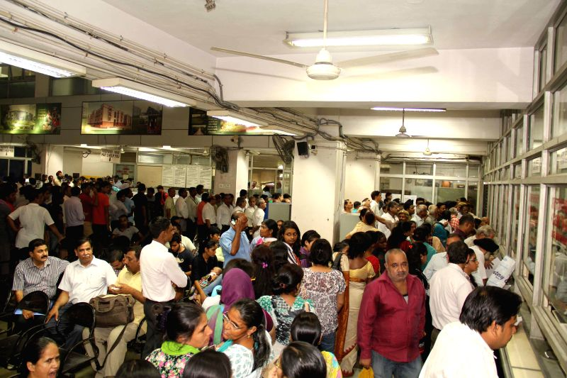 People throng Delhi Development Authority (DDA) office in New Delhi to collect forms for DDA's much-awaited 2014 housing scheme which offers 25,000 flats ranging from Rs 7 lakh to Rs 1.2 crore, which