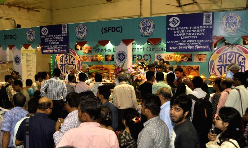 People throng food stalls at  'Ahare Bangla 2015' - a food festival organised by West Bengal government in Kolkata on Oct 30, 2015.
