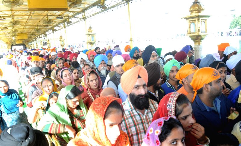 People throng the Golden Temple on Guru Nanak Jayanti in Amritsar, on Nov 25, 2015.