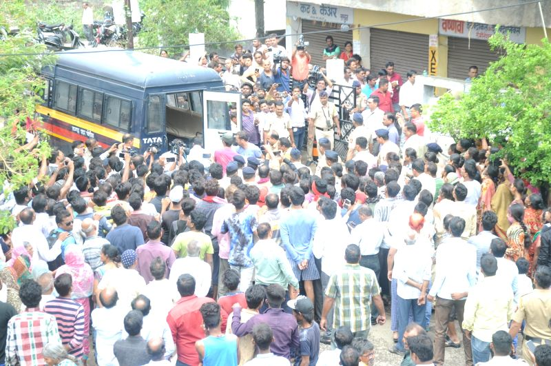 People throng the residence of BJP worker who along with four of his family members were killed, in Nagpur on June 11, 2018. According to the police, BJP worker Kamlakar Pavankar and his ...
