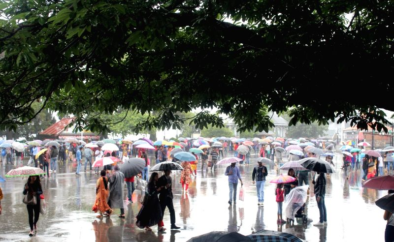 People use umbrellas to shield themselves during rains, in Shimla on July 28, 2018.