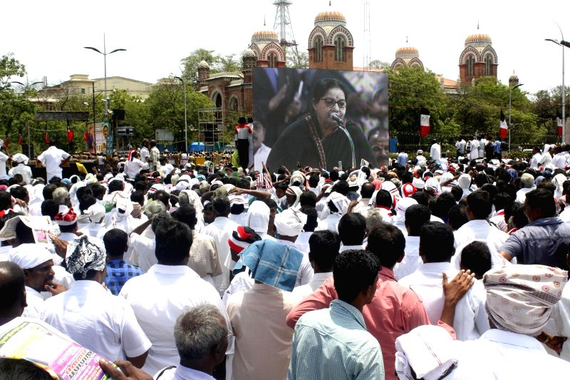 People view the swearing in ceremony of AIADMK general secretary J Jayalalithaa on a LED screen set up in Chennai, on May 23, 2016.