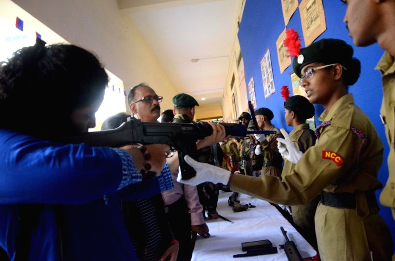 People visit a weapons exhibition in Mumbai on July 21, 2016.