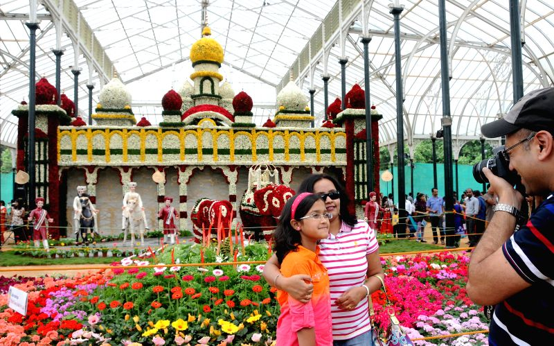 People visit Independence Day flower show organised at Glass House in Lal Bagh of Bangalore on Aug 8, 2014.