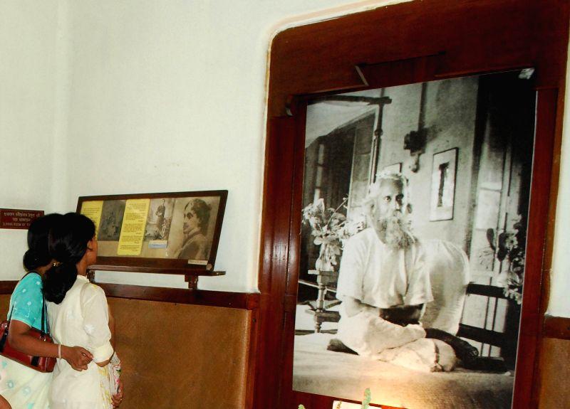 People visit Jorasanko Thakur Bari on the 153rd birth anniversary of Nobel laureate Rabindranath Tagore in Kolkata on May 9, 2014.