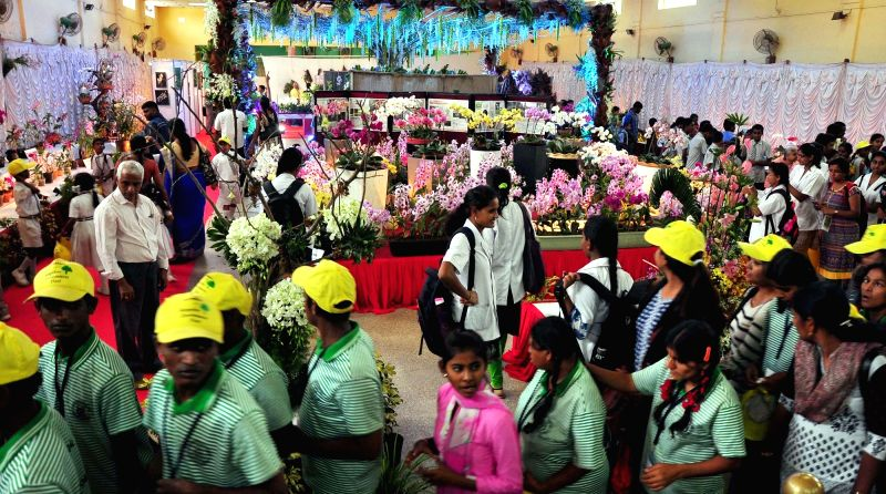 People visit Orchid flower show orgainsed by Orchid Association of Karnataka in Bengaluru, on Nov 1, 2015.