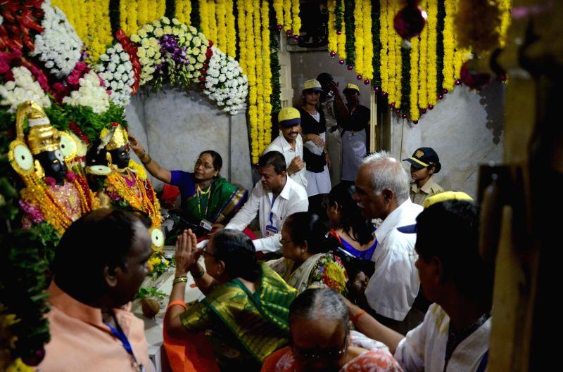 People visit Vitthal-Rukmini temple during Ashadhi Ekadashi celebrations, in Mumbai on July 23, 2018.
