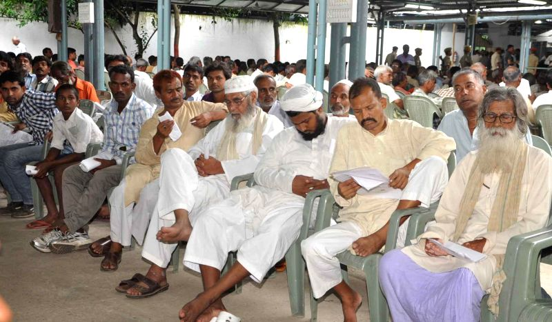 People wait for their turn to meet Bihar Chief Minister Jitan Ram Majhi during Janta Durbar in Patna on Sept 1, 2014. - Jitan Ram Majhi