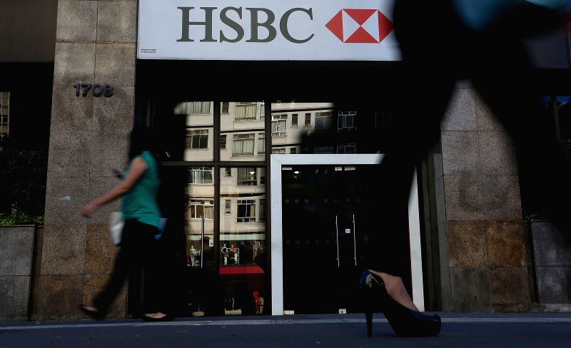 People walk in front of a branch of HSBC bank, in Sao Paulo, Brazil, on Aug. 3, 2015. According to local press, the Brazilian bank Bradesco, the second major ...