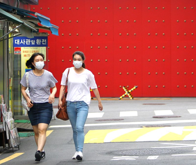 People walk past the Chinese Embassy to South Korea in Seoul, South Korea, June 24, 2015. A Chinese female patient, who was infected with MERS in South Korea, ...