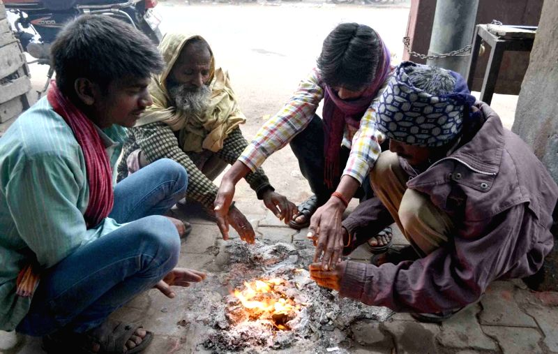 People warm themselves on a cold morning in Allahabad.