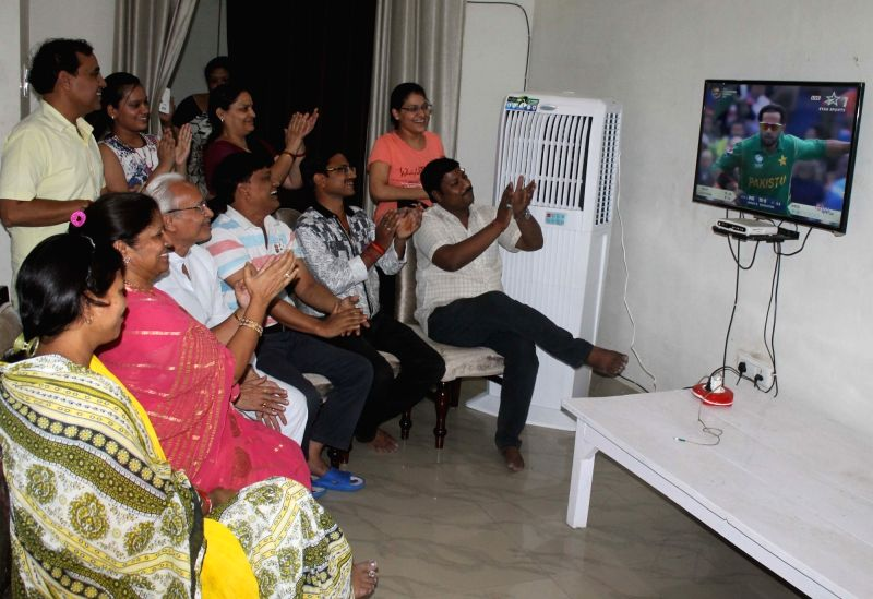 People watch ICC Champions Trophy match between India and Pakistan at their home in Mathura, on June 4, 2017. The mach is being played at Edgbaston, Birmingham in UK.