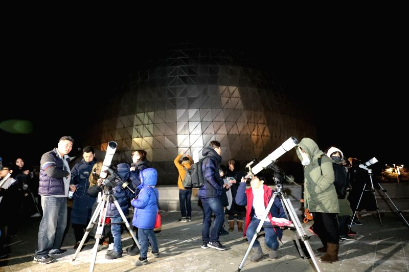 People watch the super blue blood moon at an observatory in Gwacheon, Gyeonggi Province, on Jan. 31, 2018. A super moon occurs when the moon is closest to Earth in a single orbit, a blue ...