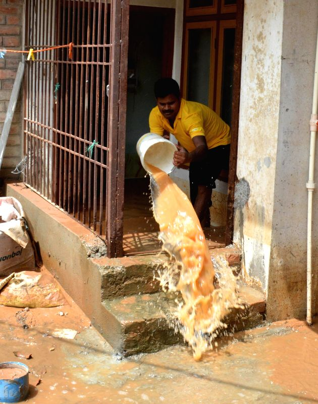 People were able to clean their establishments by throwing water outside in many areas of Guwahati on June 28, 2014.