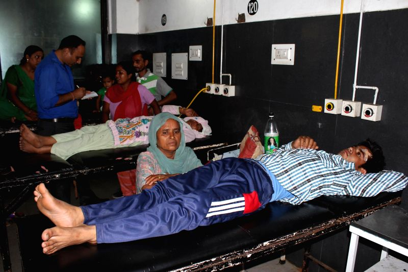 People who were injured during cross border firing at Indo-Pak border being treated at a hospital in Jammu on Aug 11, 2014. Four people, including two troopers were injured.
