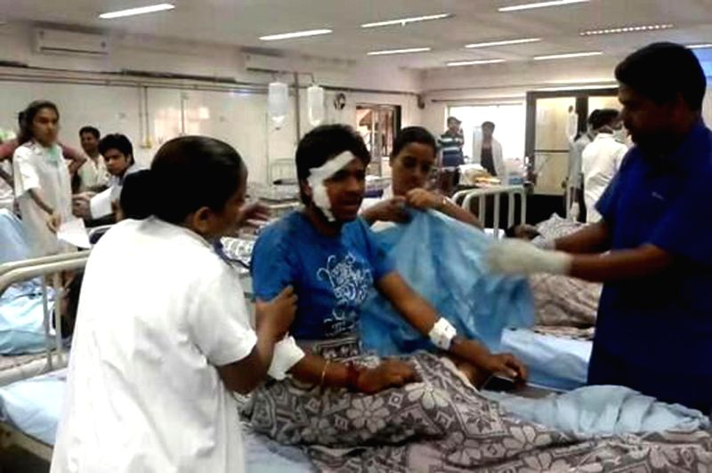 People who were injured in a fire that broke out at Waton Hotel admitted to a hospital in Navi Mumbai on Aug 8, 2014. Reportedly one person was killed and 30 others were injured in the fire.