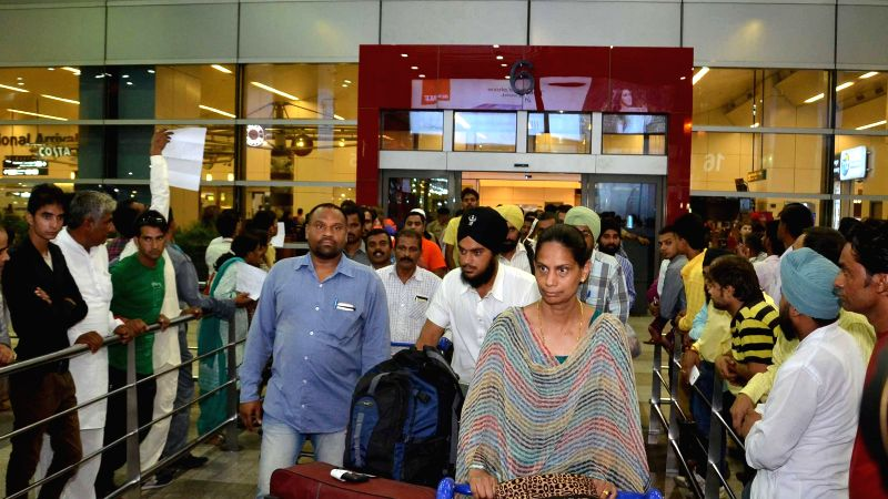 People who were stuck in violence hit Libya arrive at IGI Airport in New Delhi on Aug 7, 2014.