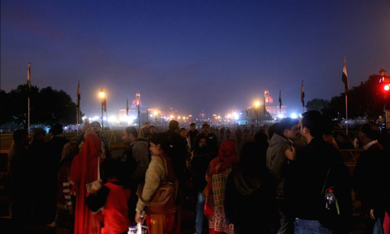 People witness an illuminated view of the North and South Block ahead of the Beating Retreat ceremony in New Delhi on Jan 27, 2018.